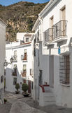 Street of Frigiliana with mountains Stock Image