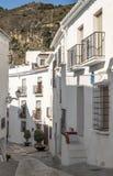 Street of Frigiliana with mountains Stock Image