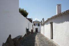 Street with white houses monsaraz Stock Photos
