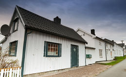 Street with white houses in Norwegian town Stock Photo