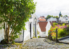 Street with white wooden houses in old centre of Stavanger. Norway. Stock Images