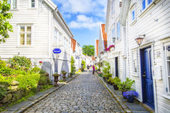 Street with white wooden houses in old centre of Stavanger. Norway. Stock Photos