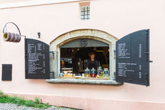 Street window cafe in Prague. Prague, Czech Republic - June 27, 2016: Street window cafe and bakery selling traditional pastry trdelnik in the old town of Prague Royalty Free Stock Photography