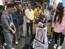 Street woman artist in Hong Kong Stock Photo