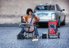 Street woman musician in Rome Stock Image