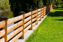 Street wooden fence of planks , horizontal frame. Street wooden fence of planks in perspective., horizontal frame royalty free stock image