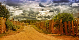 Street with wooden fences Royalty Free Stock Images