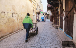 Street worker in fez medina Stock Image