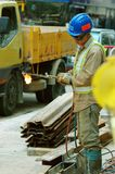 Street Worker using torch for. Worker using an acetylene torch to weld stock photography