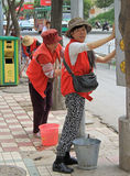 Street workers are doing some work outdoor in Kunming, China royalty free stock photo