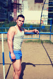 Street workout, handsome sporty man doing training Royalty Free Stock Image