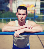 Street workout, portrait sporty man relaxing after training Royalty Free Stock Images