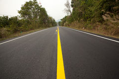 Street yellow line. Yellow line mark divined straight road Stock Images