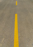 Street and yellow line. Asphalt road and straight yellow line Stock Photos
