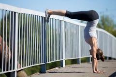 Street yoga: Downward facing Tree Pose variation Stock Images