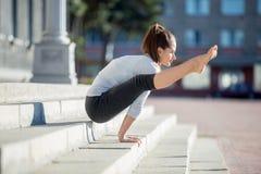 Street yoga: Firefly pose Royalty Free Stock Photo