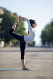 Street yoga: Lord of the dance pose royalty free stock image