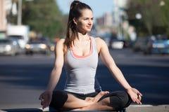 Street yoga: meditation beside the highway Royalty Free Stock Image