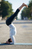 Street yoga: supported headstand yoga pose Stock Image