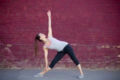 Street yoga: Utthita Trikonasana Pose Stock Image