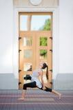 Street yoga: variation of Virabhadrasana 1 Royalty Free Stock Images