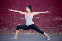 Street yoga: Virabhadrasana 2 Pose Royalty Free Stock Images