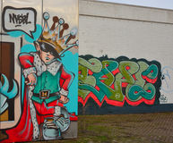 Streetart: boy dressed as a king with a large crown on his head Stock Image