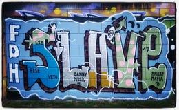 Streetart dei graffiti dello schiavo Fotografie Stock Libere da Diritti