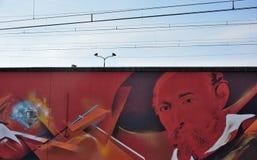 Streetart:  graffiti artist  CaZn To counter recurring graffiti vandalism, Belgian railway station Royalty Free Stock Images
