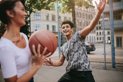 Streetball players on court playing basketball Royalty Free Stock Images