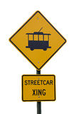 Streetcar crossing sign. Isolated yellow streetcar crossing sign on metal pole Royalty Free Stock Photography