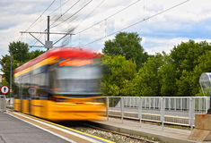 Streetcar entering the tram stop Stock Image