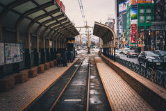 Streetcar platform in Sapporo. Sapporo, Japan - March 09, 2015: Passengers wait for a streetcar at an empty station in Sapporo, Japan Stock Images