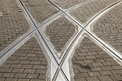 Streetcar or tram rails in old cobble stone street Royalty Free Stock Images