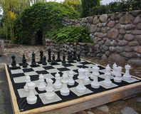 Streetchess pieces at a square. Board of a chess game. A peaceful scene of an outdoor chess match in a park. Stock Photo