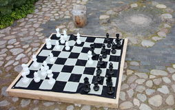 Streetchess pieces at a square. Board of a chess game. A peaceful scene of an outdoor chess match in a park. Royalty Free Stock Photos