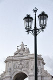 Streetlamp. In the background, the top of the Arco do Triunfo. B Stock Photo