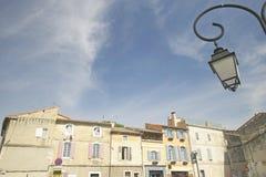 Streetlamp and buildings in Arles, France Stock Image