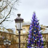 Streetlamp and Christmas tree in the background Royalty Free Stock Photo