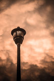 Streetlamp Clouds. Street lamp post against dramatic cloudy sky stock photo