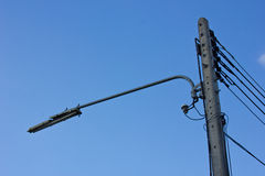 Streetlamp with electric pole. Electric pole with street lamp on blue sky Stock Image