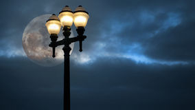 Streetlamp and full moon Stock Photography