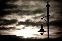 Streetlamp på solnedgången Arkivfoto