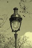 Streetlamp in Paris with old postcard effect Royalty Free Stock Photos