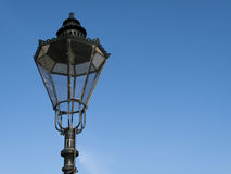 Streetlamp. Period styled cast iron streetlamp against a clear blue sky Royalty Free Stock Images