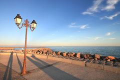 Streetlamp on the seaside  and shadow Royalty Free Stock Photography