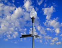 Streetlamp and Sign Stock Photography