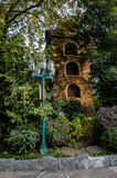 Streetlamp and tower in bush Stock Photography