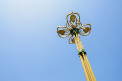 Streetlamp towering in blue sky Stock Photos