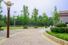Streetlamps on circular square before Chinese old-fashioned cast Stock Photo